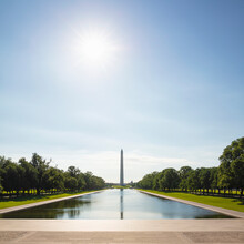 USA, Washington DC, Sun Shining Over Lincoln Memorial Reflecting Pool With Washington Monument In Background