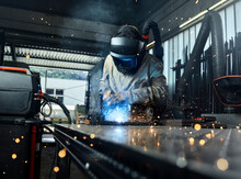 Metal Worker Wearing Protective Workwear Welding Metal While Working At Factory