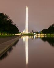 USA, Washington DC, Washington Monument Reflecting In Lincoln Memorial Reflecting Pool At Night