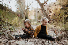 Kids Playing In The Forest In Autumn In Rubí Barcelona Spain