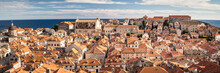 Croatia, Dubrovnik, Old Town Buildings With Orange Rooftops With Sea In Background