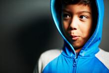 Boy Wearing Hooded Top