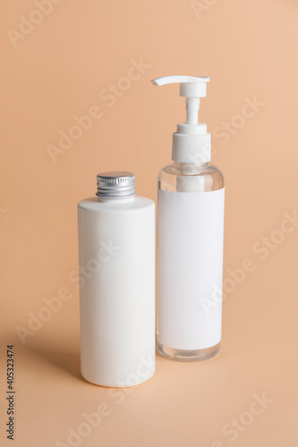 Obraz Different bottles of cosmetic products on color background - fototapety do salonu