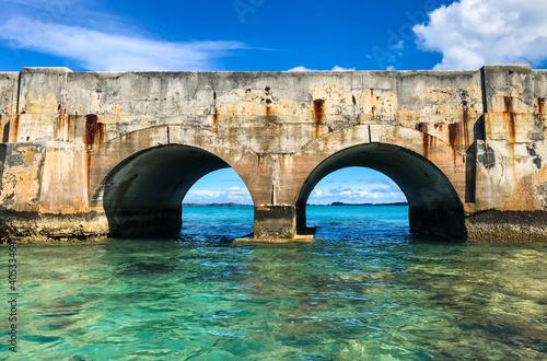 Obraz Bridge Over Sea Against Blue Sky - fototapety do salonu