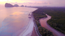 High Angle View Of Sea Shore Against Sky During Sunset