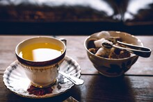 Close-up Of Tea And Breakfast On Table