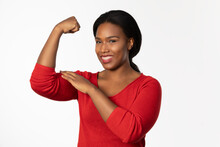 African-American Woman Curls Her Arm To Pat Her Bicep 0627