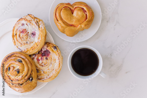 Obraz High Angle View Of Coffee Cup With Sweet Food On Table - fototapety do salonu
