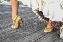 Closeup Shot Of A Bride Showing Her Vint Leather Shoes