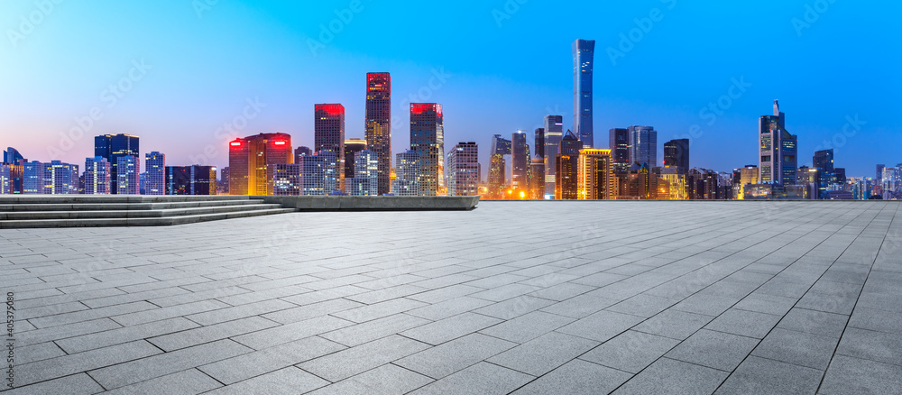 Fototapeta Empty square floor and modern city commercial buildings in Beijing at night,China.