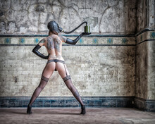 Full Length Of Sensuous Naked Woman Wearing Gas Mask While Standing Against Wall