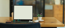 Portable Workspace With Tablet, Smartphone And Accessories In Co Working Space