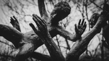 Dark And Moody Sculpture Of People Falling