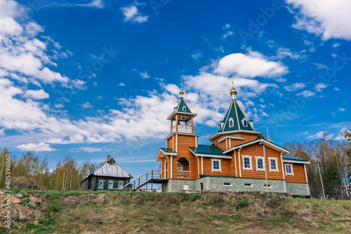 Orthodox Christian modern wooden Church in a village in Russia on a summer day