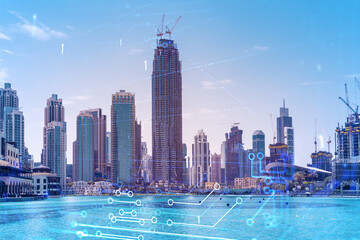 Skyscrapers of Dubai business downtown. International hub of trading and financial services. Technology theme icons hologram, Fintech concept. Double exposure. Dubai Canal waterfront.