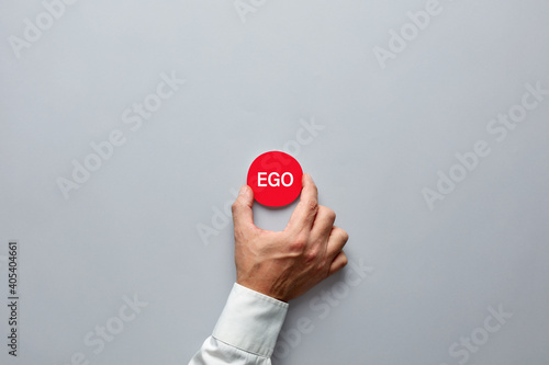 Businessman hand holding a red badge with the word ego. Wallpaper Mural