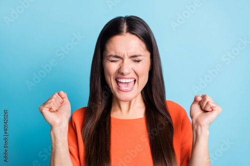 Fotografering Photo of impressed person shouting loud open mouth closed eyes fists up isolated