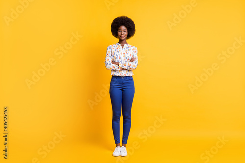 Full length photo of cute positive dark skin lady dressed casual outfit glasses arms folded isolated yellow color background