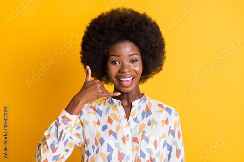 Portrait of attractive cheerful person show hand fingers call me isolated on vibrant color background