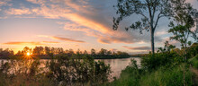 Beautiful Panoramic Riverside Sunset With Reflections