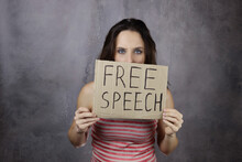 Young Woman Holds A Banner With The Inscription Free Speech, Censorship Concept