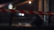 Leinwandbild Motiv Detectives standing at crime scene near dead body on blurred background
