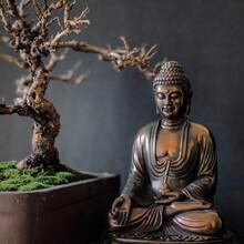 Close-up Of Buddha Statue By Bonsai Tree