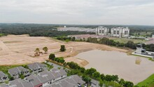 Upcoming Neighbourhood On New Land Deforested For Housing - Pan Left To Right