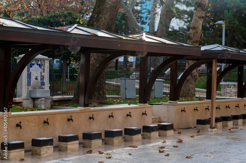 Fotografering Beautiful outdoor stone benches for ritual ablution in the mosque
