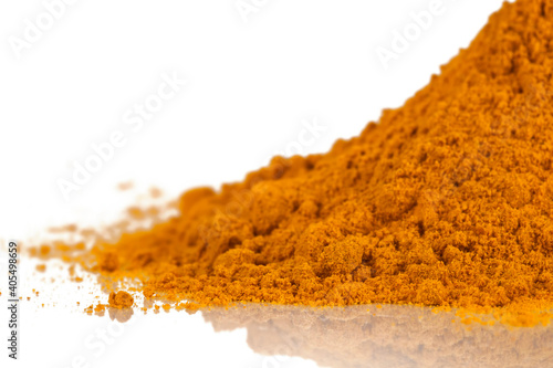 Obraz Heap of turmeric powder spice isolated on a white background. - fototapety do salonu