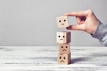 Wooden Cubes With Drawings Of Different Emotions: Sadness, Anger, Calmness, Joy. Choosing Joy In Life