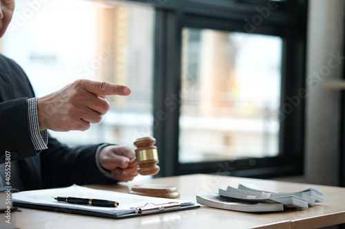 Photo Midsection Of Man Holding Gavel And Pointing Sitting At Desk
