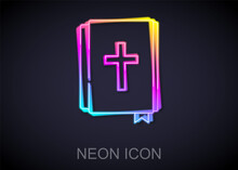 Glowing Neon Line Holy Bible Book Icon Isolated On Black Background. Vector.