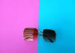 Leinwandbild Motiv Close-up Of Sunglasses Over Colored Background