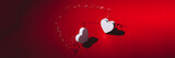 Two white wooden hearts with strong shadows on red background connected together, as symbol of love and passion, Happy Valentines Day Concept, banner size