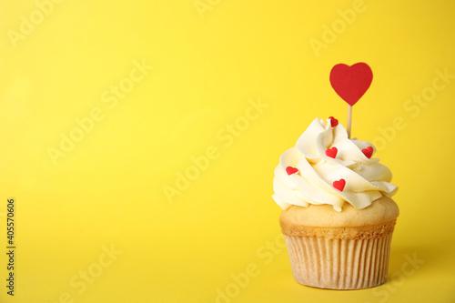 Obraz Tasty cupcake on yellow background, space for text. Valentine's Day celebration - fototapety do salonu