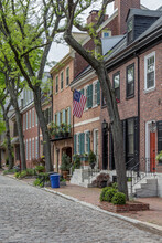 Philadelphia Street Scene In Historical Society Hill Section Of The City.  Showing Colonial Homes On A Cobblestone Street.