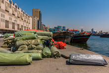 Loading Dhow Cargo Vessels On The Dubai Creek In The UAE In Springtime