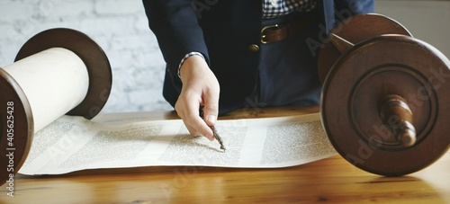 Photo Midsection Of Person Reading Torah