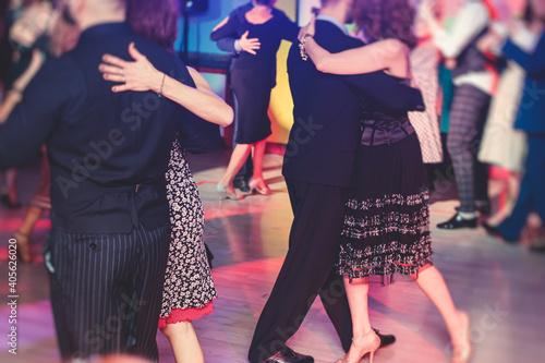 Leinwand Poster Couples dancing traditional latin argentinian dance milonga in the ballroom, tan