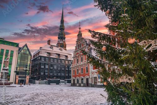Obraz Riga, Latvia - January 10, 2021: House of the Blackheads, building situated in winter Christmas Riga in Latvia. - fototapety do salonu