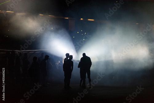 Canvas Print Silhouette People In Illuminated Stadium