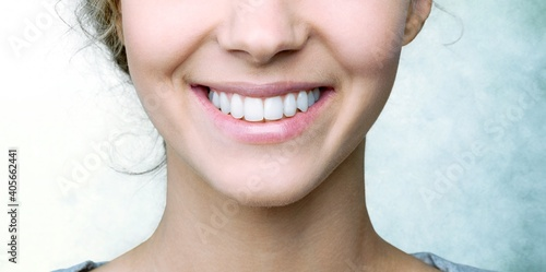 Fotografie, Obraz Beautiful smile of young woman with healthy white teeth