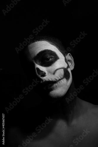 Obraz Portrait Of Man With Face Paint Against Black Background - fototapety do salonu