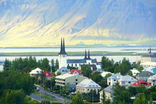 The Buildings And Residential Area In The City On A Bright Summer Evening Near Reykjavik, Iceland