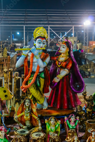 Lord Krishna playing flute and Radha smiling lovingly, terracotta dolls made in Krishnanagar, Nadia, West Bengal, for sale in Handicraft Fair in Kolkata.