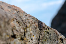 Low Angle View Of Rocks On Rock Against Sky