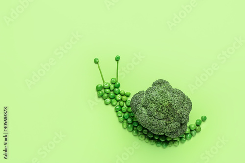 Fotografie, Obraz Snail made of vegetables on color background