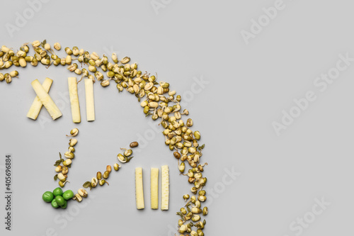 Fotografie, Obraz Clock made of food on grey background