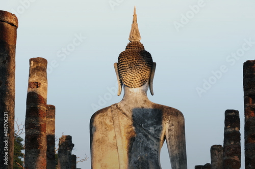 A Buddha statue at Mahathat Temple in the precinct of Sukhothai Historical Park Tapéta, Fotótapéta